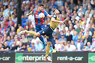 Olivier Giroud of Arsenal and Joel Ward of Crystal Palace leaping for the ball. Barclays Premier league match, Crystal Palace v Arsenal at  Selhurst Park in London on Sunday 16th August 2015.<br /> pic by John Patrick Fletcher, Andrew Orchard sports photography.