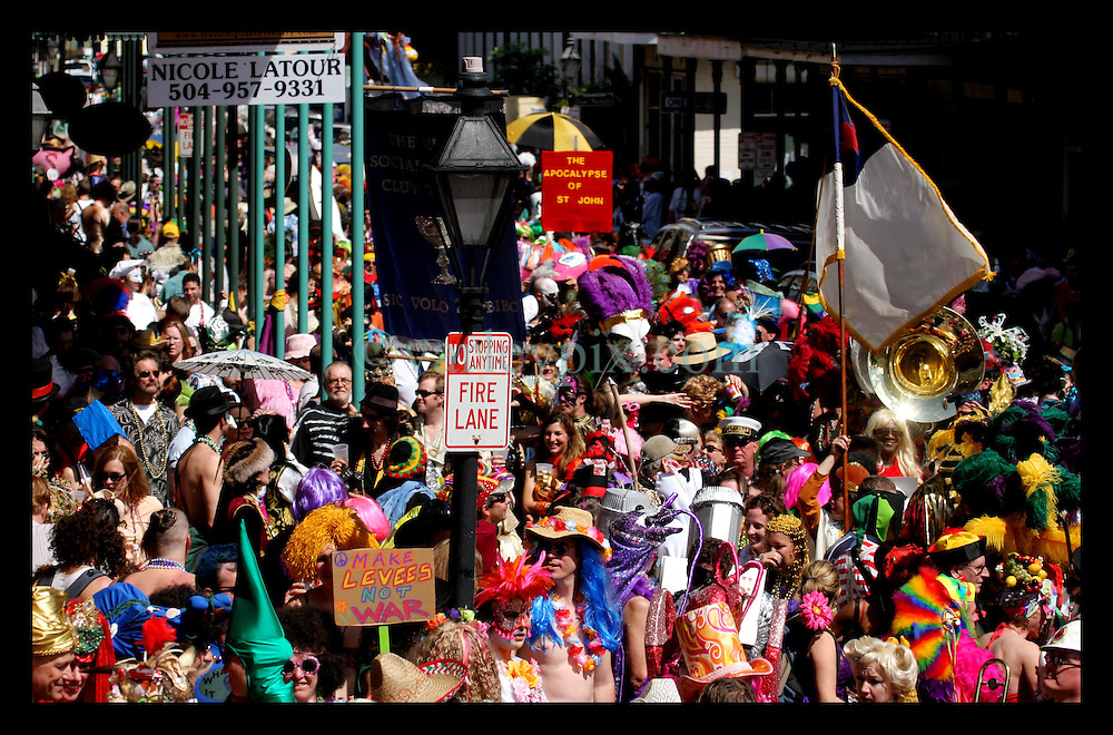 Feb 28th, 2006. New Orleans, Louisiana. Mardi Gras Day, Fat Tuesday. Crowds and faces in the crowd pack Chartres Street in the French Quarter for the annual St Anne's day parade. St Anne's parade traditionally sees participants dress up in all manner of bright original costumes.