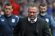 Aston Villa manager Paul Lambert walks to the bench before kick off, closely followed by his assistants. Barclays Premier League match, Aston Villa v Arsenal at Villa Park in Birmingham on Saturday 20th Sept 2014<br /> pic by Mark Hawkins, Andrew Orchard sports photography.