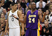 Utah Jazz forward Enes Kanter of Turkey (0) looks on as Los Angeles Lakers shooting guard Kobe Bryant (24) reacts after getting charged with a technical foul during the first half of an NBA basketball game, Saturday, Feb. 4, 2012, in Salt Lake City. (AP Photo/Colin E Braley).