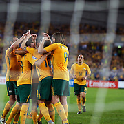 Harry Kewell is congratulated by team mates after scoring from the penalty spot during the 2010 Fifa World Cup Asian Qualifying match between Australia and Uzbekistan at Stadium Australia in Sydney, Australia on April 01, 2009. Australia won the match 2-0.  Photo Tim Clayton