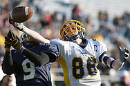 Wilmington's Matt Wagner reaches for a pass with West Catholic's Ray Manuel defending in the 2008 PIAA Class AA State Championship game.