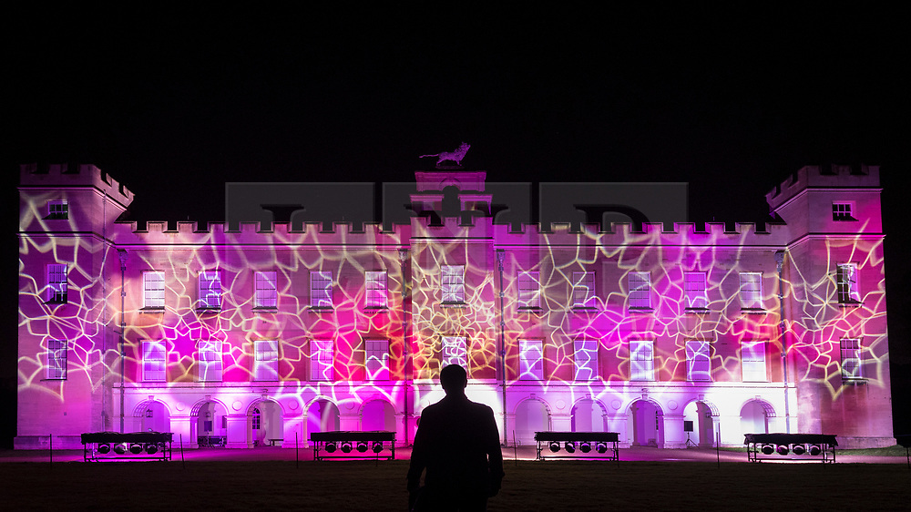 © Licensed to London News Pictures. 11/11/2018. LONDON, UK.  A visitor is seen in silhouette during a projection show in The Enchanted Woodland which has opened to the public again at Syon House in West London.  An illuminated trail takes visitors through gardens designed by Capability Brown, round an ornamental lake and ends at the spectacular Great Conservatory.   Photo credit: Stephen Chung/LNP