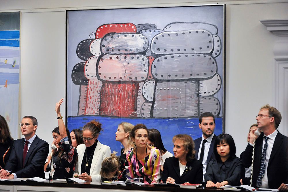 © Licensed to London News Pictures. 05/10/2017. London, UK.  'Odessa', 1977, by Philip Guston sold for a hammer price of GBP3,200k (Est. GBP2,500-3,500k) at the Italian and Contemporary Art evening auction at Sotheby's, New Bond Street, coinciding with the opening of the London's Frieze Art Fair. Photo credit : Stephen Chung/LNP