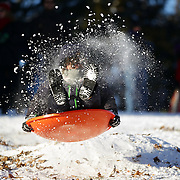 A boy goes airborne while sledding in Central Park after New York City was hit with over 7 inches of snow during its first winter storm of the year. Central Park, Manhattan, New York, USA. 4th January 2014 Photo Tim Clayton