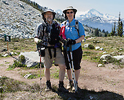 Tom and Carol hike the Overlord Trail on Blackcomb Mountain, in the Coast Range, British Columbia, Canada. The Resort Municipality of Whistler is popular for year-round  outdoor sports aided by gondolas and chair lifts. For licensing options, please inquire.