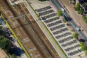 Nederland, Drenthe, Assen, 27-08-2013;<br /> Fietsenstalling langs de spoorbaan in Assen.<br /> Bicycle parking along the railway in Assen.<br /> luchtfoto (toeslag op standaard tarieven);<br /> aerial photo (additional fee required);<br /> copyright foto/photo Siebe Swart.
