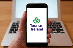 Using iPhone smartphone to display logo of Tourism Ireland organisation