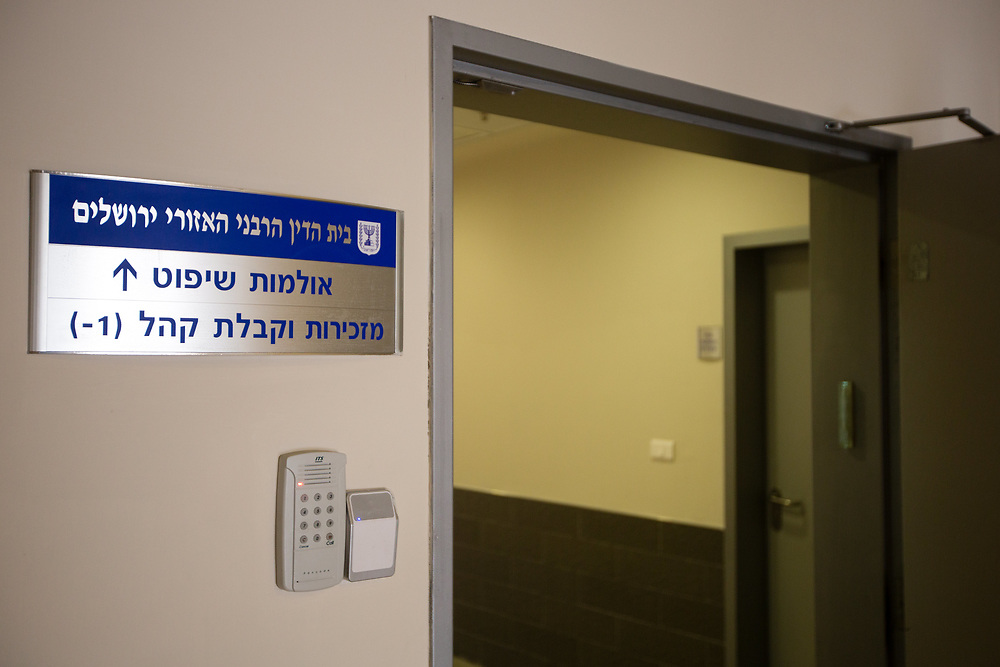 A sign shows the way towards a courtroom at the Rabbinical Court in Jerusalem, Israel, on March 22, 2016.