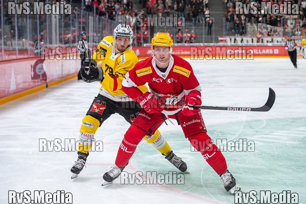LAUSANNE, SWITZERLAND - SEPTEMBER 28: TopScorer Jiri Sekac #92 of Lausanne HC in action with Thierry Bader #79 of SC Bern during the Swiss National League game between Lausanne HC and SC Bern at Vaudoise Arena on September 28, 2021 in Lausanne, Switzerland. (Photo by Monika Majer/RvS.Media)