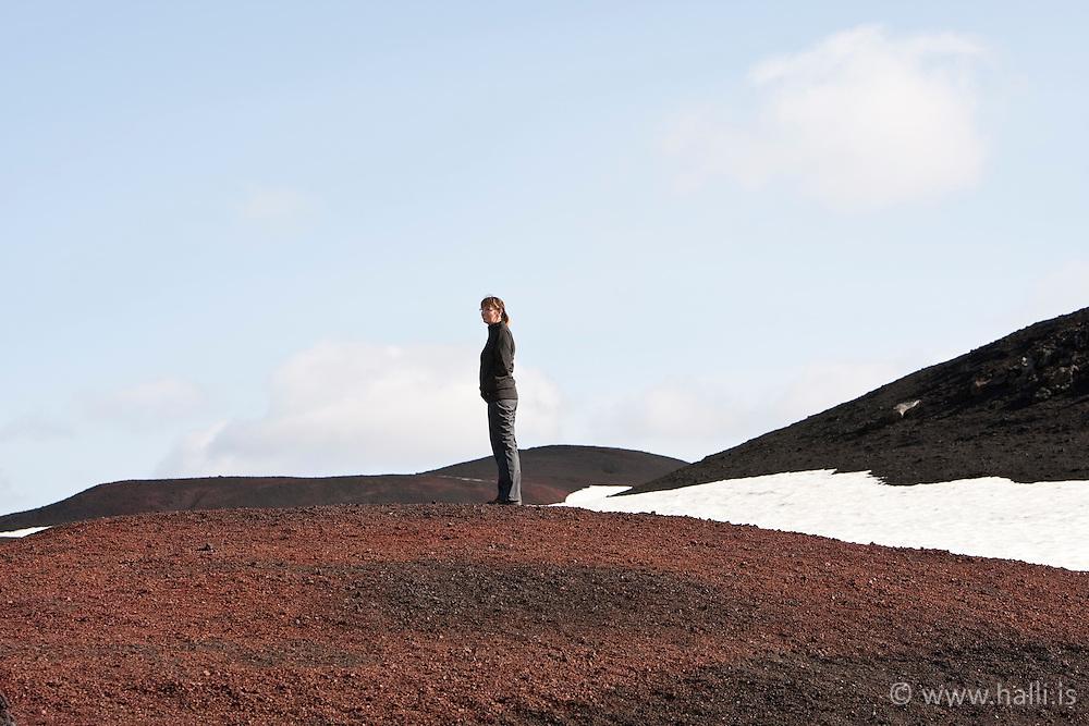 Woman standing in lave on a hill, highlands of Iceland - Kona stendur í hrauni, Öskjuleið