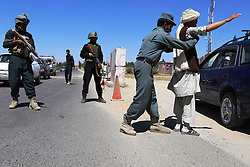 GHAZNI, Sept. 7, 2016 (Xinhua) -- An Afghan policeman searches a passenger during a military operation in Ghazni province, Afghanistan, Sept. 6, 2016. Up to 80 Taliban militants have been killed as their attack on Afghanistan's eastern Ghazni province has been repelled, provincial Governor Abdul Karim Matin said Wednesday. (Xinhua/Sayed Mominzadah).****Authorized by ytfs* (Credit Image: © Sayed Mominzadah/Xinhua via ZUMA Wire)