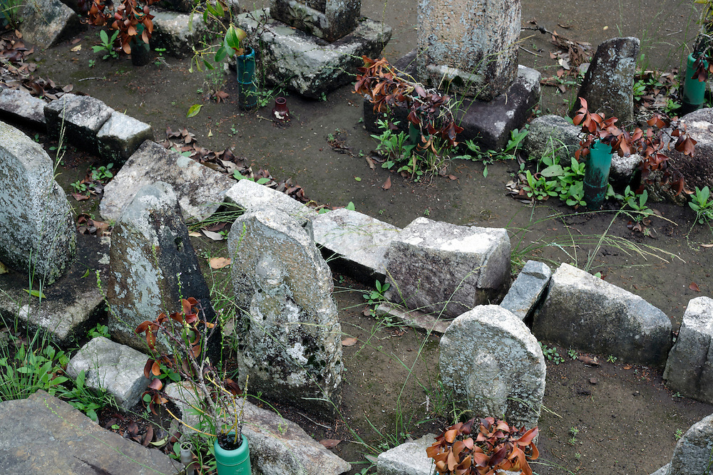 old weathered grave monuments Japan