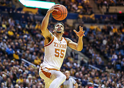 Feb 9, 2019; Morgantown, WV, USA; Texas Longhorns guard Elijah Mitrou-Long (55) shoots during a fast break during the first half against the West Virginia Mountaineers at WVU Coliseum. Mandatory Credit: Ben Queen-USA TODAY Sports