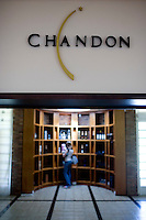 A patron looks over bottle of sparkling wine in the store at Bodega Chandon in Mendoza, Argentina.