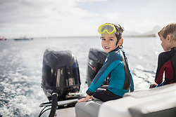 Children with diving mask on a boat, Mauritius