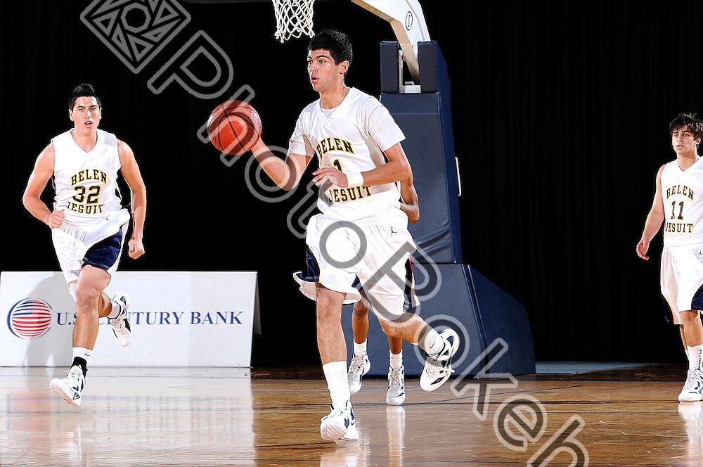 2012 January 13 - Belen's Emmanuel Noya (1) handling the ball. Belen Jesuit Wolverines variety basketball fell to the Columbus Explorers, 58-54, at the U.S. Century Bank Arena, Miami, Florida. (Photo by: www.photobokeh.com / Alex J. Hernandez) 1/250 f/8 ISO400 150mm