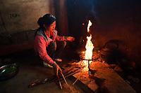Cooking, in the Tsai family, Xiang Bai Lisu village, Tongbiguan nature reserve, Dehong prefecture, Yunnan province, China