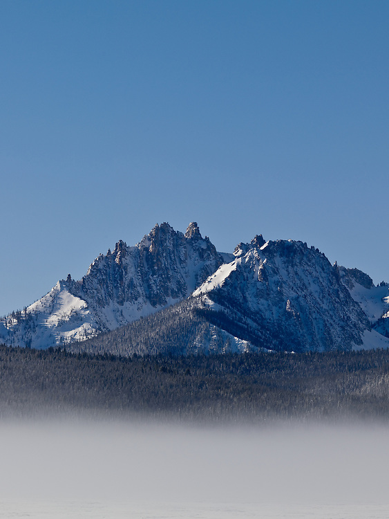 Sub-zero temperature from Stanley Idaho with a cold fog rolling across the meadows with Heyburn Peak at 10,112 feet in the Sawtooth Mountain Range in winter near Redfish Lake