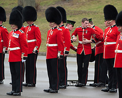© London News Pictures. 17/03/2012. Aldershot, UK. A soldier being picked up by officers after fainting at a St Patrick's Day parade at Mons Barracks in Aldershot, Hampshire, UK, on March 17th, 2012 which was attended by The Duchess of Cambride CATHERINE (KATE) MIDDLETON.  Photo credit : Ben Cawthra/LNP.