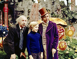 GENE WILDER, (born Jerome Silberman, June 11, 1933 - August 28, 2016) was an American stage and screen comic actor, screenwriter, film director, and author. He was known best for the lead role in the 1971 film 'Willy Wonka in Willy Wonka & the Chocolate Factory,' and the Mel Brooks comedies 'Blazing Saddles', and 'Young Frankenstein', which Wilder co-wrote, garnering the pair an Academy Award nomination for Best Adapted Screenplay. Wilder died at age 83 from complications from Alzheimer's disease. PICTURED: (L-R) JACK ALBERTSON as Grandpa Joe, PETER OSTRUM as Charlie Bucket, and GENE WILDER as Willy Wonka, in a scene from the 1971 film 'Willy Wonka and the Chocolate Factory,' based on the children's classic by Roald Dahl. (Credit Image: © Courtesy of ABC Family/Entertainment Pictures/ZUMAPRESS.com)