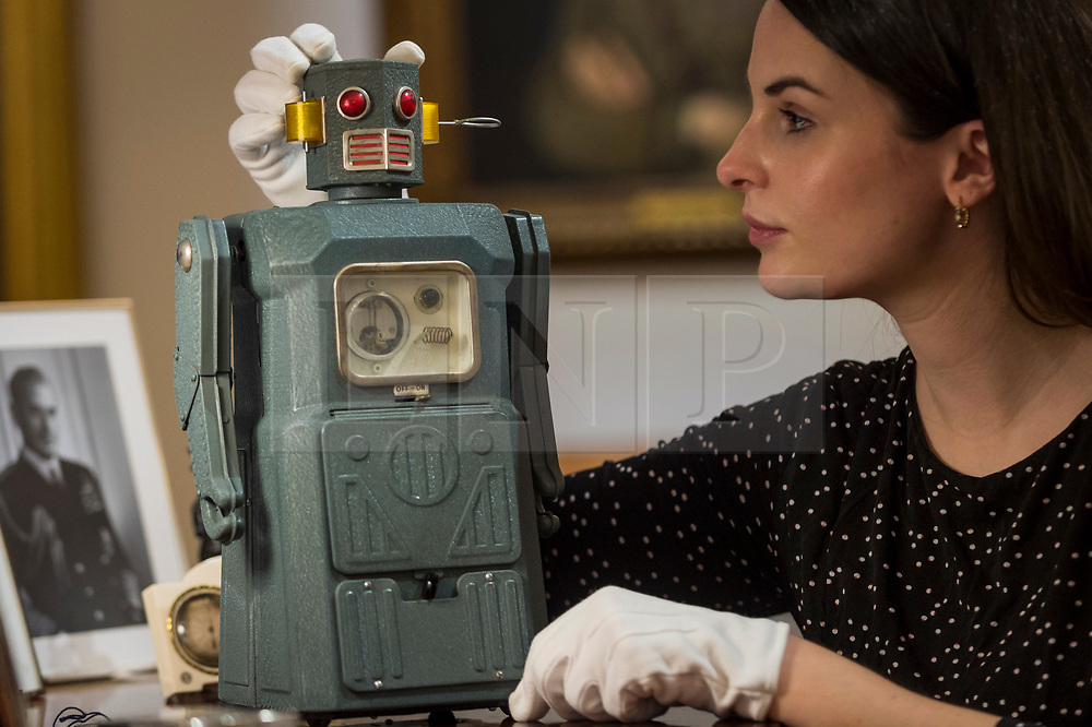 """© Licensed to London News Pictures. 19/03/2021. LONDON, UK. A staff member views a """"rare TM (Masudaya) battery-operated Radicon Robot, 1957"""" (est. £4,000-6,000).  Preview of the upcoming sale of property from the collection of the Patricia Knatchbull, 2nd Countess Mountbatten of Burma.  Over 350 lots spanning jewellery, furniture, paintings, sculpture, books, silver, ceramics & objets d'art are to be auctioned on 24 March at Sotheby's New Bond Street galleries.  Photo credit: Stephen Chung/LNP"""
