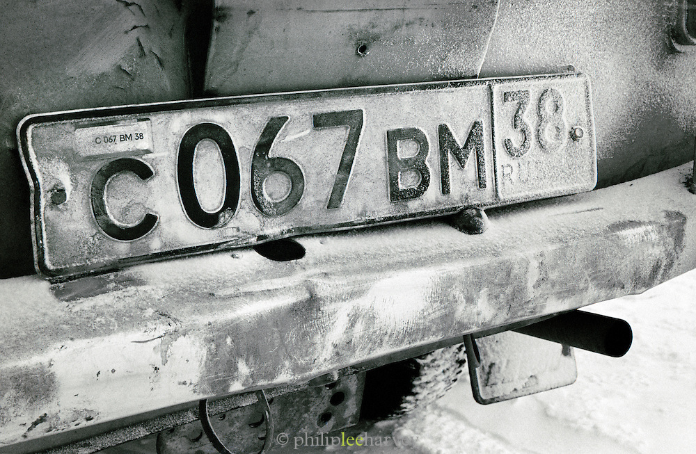 Car number plate with snow, Lake Baikal, Siberia, Russia