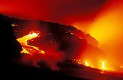 Lava flow entering the Pacific Ocean at night, Hawaii Volcanoes National Park, The Big Island, Hawaii