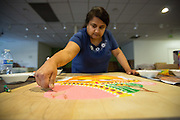 Naina Amin gently lays colored sand onto a black board during the Diwali Rangoli competition at the Shreemaya Krishnadham Temple in Milpitas, California, on November 2, 2013. (Stan Olszewski/SOSKIphoto)
