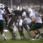 Central Florida running back Brynn Harvey (34) runs  in the rain during an NCAA football game between the Marshall Thundering Herd and the Central Florida Knights at Bright House Networks Stadium on Saturday, October 8, 2011 in Orlando, Florida. (Photo/Alex Menendez)