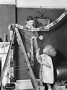 Children Hanging Christmas Decorations, England, 1932
