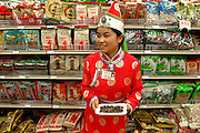 Many restaurants and markets in China hew closely to Western models, right down to the workers offering samples. Here a worker is offering samples in a faux-Mongolian outfit. Hungry Planet: What the World Eats (p. 80). This image is featured alongside the Dong family images in Hungry Planet: What the World Eats.