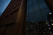 DALLAS, TX - SEPTEMBER 2: Downtown Dallas reflected in the windows of the parking garage where on July 7, 2016 Micah Johnson ambushed a group of Dallas police officers during a Black Lives Matter march through downtown Dallas, Texas killing 5 officers seen on September 2, 2016. (Photo by Cooper Neill for The Washington Post)