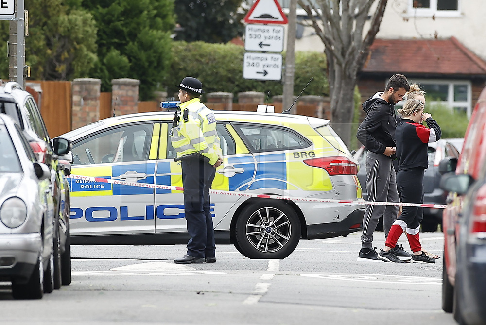 © Licensed to London News Pictures. 19/06/2020. London, UK. The scene in North Cheam after a fatal shooting. Police were called at 01:12hrs on Friday, 19 June to reports of shots fired on Brocks Drive in North Cheam. Officers, including firearms officers, attended, and found a man, believed to be in his mid-20s, in the street suffering from a gunshot injury. They immediately provided first aid. The London Ambulance Service and London's Air Ambulance also attended but despite the efforts of officers and paramedics, the man was pronounced dead at the scene at 01:45hrs. Photo credit: Peter Macdiarmid/LNP