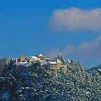 An old castle tops a hill above Risnov village, Romania.