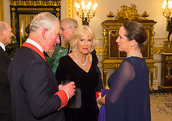 The Prince of Wales and the Duchess of Cornwall (centre) with Princess Zahra Aga Khan in the White Drawing Room at Windsor Castle, during a reception before a private dinner to mark the diamond jubilee of the Aga Khan's leadership as Imam of the Shia Ismaili Muslim Community.