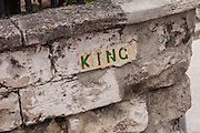 Old street sign on a coral stone wall in Nassau , Bahamas.