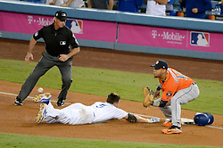 November 1, 2017 - Los Angeles, CA, United States - Dodgers Corey Seager, #5, was safe as first on this play as the throw to Astros Yuli Gurriel, #10, was late during 3rd inning in game 7 at the World Series at Dodger Stadium Wednesday, November 1, 2017. (Credit Image: © David Crane/Los Angeles Daily News via ZUMA Wire)