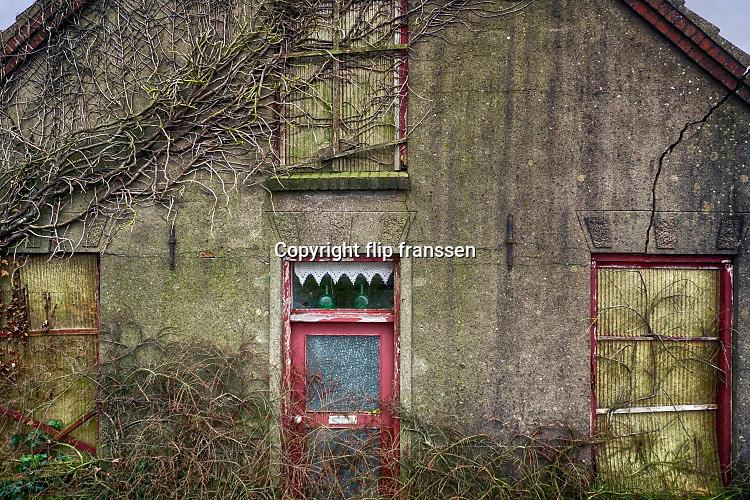Nederland, Kekerdom, 28-1-2018Een vervallen woning langs de dijk .Foto: Flip Franssen