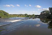 Weir on the River Avon in the Vale of Evesham, Fladbury, Worcestershire, England