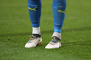AFC Wimbledon player wearing rainbow laces during the EFL Sky Bet League 1 match between AFC Wimbledon and Southend United at the Cherry Red Records Stadium, Kingston, England on 24 November 2018.