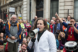 London, UK. 14 October, 2019. Dr Emily Grossman addresses climate activists from Scientists for Extinction Rebellion who had blocked the busy junction at King William Street in front of London Bridge on the eighth day of International Rebellion protests across London. Today's activities were concentrated around the  City of London's finance district.