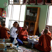 "May 14, 2013 - Mandalay, Myanmar: Ashin Wirathu (centre), the spiritual leader of Burma's Buddhist Nationalist anti-Muslim movement 969 group, takes a midday meal offered by regular citizens at Mosayein Monastery in central Mandalay. Wirathu, who was jailed in 2003 for inciting religious hatred, refers to himself as ""the Burmese Bin Laden"". CREDIT: Paulo Nunes dos Santos"