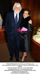 ROSE MARIE BRAVO Chief Executive of Burberry and her husband BILL JACKEY, at a party in London on 29th October 2003.PNX 39