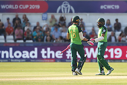 June 28, 2019 - Chester Le Street, County Durham, United Kingdom - Faf du Plessis and Hashim Amla shake hands after South Africa's victory    during the ICC Cricket World Cup 2019 match between Sri Lanka and South Africa at Emirates Riverside, Chester le Street on Friday 28th June 2019. (Credit Image: © Mi News/NurPhoto via ZUMA Press)