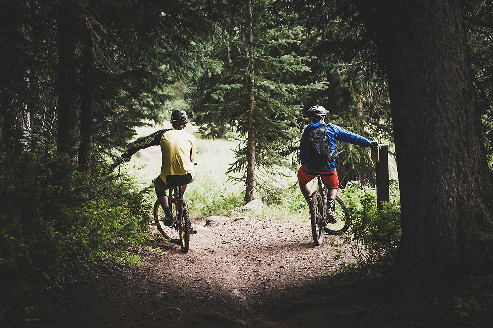 Sasha Yakovleff and Ben Duke take a moment while riding the Great Western Trail, Wasatch Mountains, Utah.