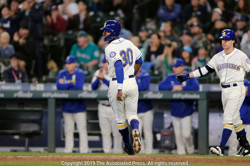 Seattle Mariners' Kyle Lewis scores from third on a hit against the Chicago White Sox during the fourth inning of a baseball game, Sunday, Sept. 15, 2019, in Seattle. (AP Photo/John Froschauer)