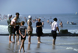D. Ross Cameron 8/89<br /> <br /> Mennonite followers soak their feet in  decidedly conservative bathing suits in the Atlantic Ocean at Rehoboth Beach, Del.