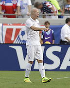 JACKSONVILLE, FL - JUNE 07:  Midfielder Michael Bradley #4 of the United States yells over at forward Clint Dempsey #8 (not pictured) during the international friendly match against Nigeria at EverBank Field on June 7, 2014 in Jacksonville, Florida.  (Photo by Mike Zarrilli/Getty Images)