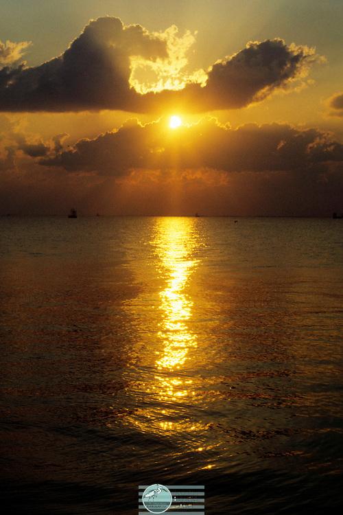 Sun Peeking Thru Clouds Sunset